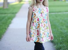 Noodlehead: vintage may: bunny tunic.  No tutorial, but it's pretty basic.  Love the pleats!