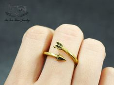 Bow and Arrow adjustable Ring! ------------------------------------------------- US Size : 8 - 11 Color: Gold Quantity: 1 pc ------------------------------------------------- Your jewelry will arrive in a gift box.  Handling time:  Please allow 1-3 business days for us to process your or...