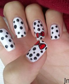 White with black polka dots and red bows