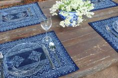 Beautiful rich indigo batik placemats. Traditional Hmong batik on cotton dyed with natural indigo. Bring a bit of this traditional style to your next dinner party.***Sold Individually***4 patterns availablepattern 1 - 6 availablepattern 2 - 4 avai...