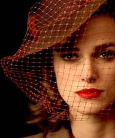 keira knightley in a 30s inspired veiled fedora