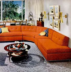 Orange sectional and grey carpet. 1954.