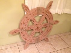 Ship wheel ...Cut cardboard and painted it then wrapped a little twine