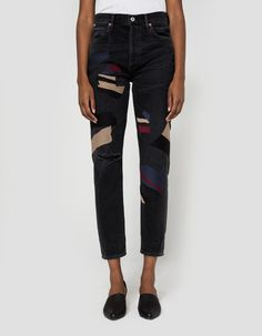 In an exclusive collaboration between Need Supply Co. and Citizens of Humanity, stylized jeans in a washed black Outsider. Button fly. Classic five-pocket styling. Branded buttons and rivets. Modern embroidered geometric details at legs. Moderate distress