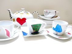 Cheshire Cat Teacup and Saucer by SwirlyGarden on Etsy, $28.00