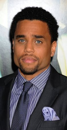 Mmm... Those blue eyes and square jaw.... I love light eyes and dark skin!   Michael Ealy :)