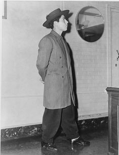 With its long coat and wide-legged pegged trousers, the zoot suit became popular with young men in the early 1940s. The zoot suit is said to have emerged from either Mexican-American immigrant workers or African-American culture. The style was quickly adopted by a large group of ethnicities.