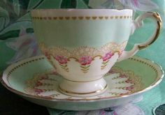 Pretty Mint Green & White Teacup & Saucer with Pink Band of Flowers