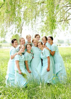 Such a beautiful group of young ladies and beautiful dresses.