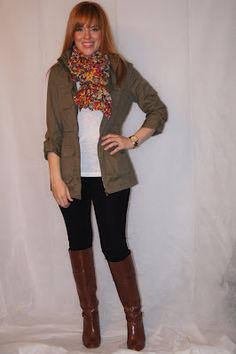 Black skinny jeans, brown knee-high boots, army jacket, scarf, casual fall outfit.