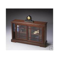 Butler Antique Cherry Bookcase Console 3043011. h1Butler Antique Cherry Bookcase Console 3043011_h1This Shaker-inspired Butler Antique Cherry Bookcase Console 3043011 is crafted from select hardwood solids, wood products and choice veneers, it features a cherry veneer .. . See More Bookcases at http://www.ourgreatshop.com/Bookcases-C679.aspx