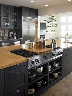 Kitchen color scheme ideas for dark cabinets 08 island with stove, kitchen Kitchen Island With Stove, Black Kitchen Cabinets, Black Kitchens, New Kitchen, Home Kitchens, Kitchen Dining, Kitchen Decor, Kitchen Islands, Kitchen Ideas