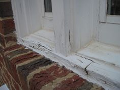 Signs of wood rot around a window from neglected paint
