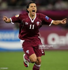 Qatar's midfielder Fabio Cesar celebrates after scoring his team's third goal against Kuwait during their 2011 Asian Cup group A football match at...