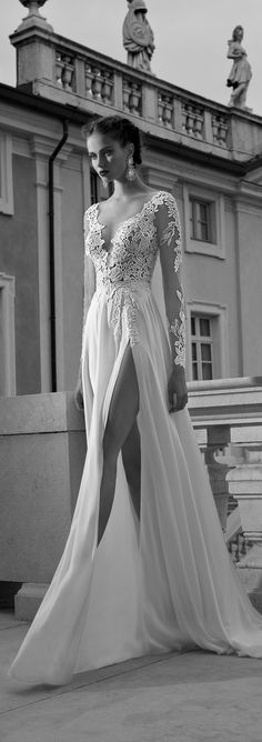 Long sleeves and thigh high splits make for a seriously gorgeous wedding dress combination, don't you think? LOVE this @bertabridal gown.