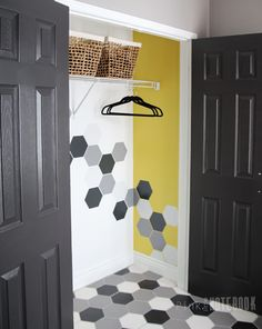 A Front Foyer makeover – Before & After. A modern yet youthful design using pattern tile in black, white, grey. Unexpected bold closet design | pink little notebook