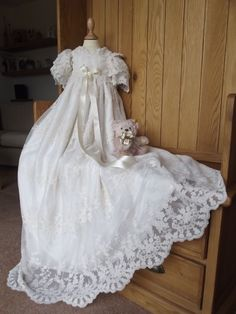 A beautiful christening gown which is suitable for boys and girls and so is a classic heirloom which can be passed down the generations of your family. Designed to be reminiscent of the christening gowns used by the aristocracy and royal families of bygone days and now enjoying a renaissance thanks to our own royal family here in the United Kingdom. The Windsor christening gown has short, waterfall style sleeves just like Prince Georges christening gown.