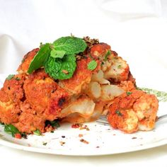 Low cal, healthy, baked whole cauliflower. Vegetarian alternative to chicken tikka.