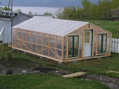 - Diy Garden Greenhouse With Recycled Windows and Poly Extend your gardening season by building a DIY greenhouse.Extend your gardening season by building a DIY greenhouse. Greenhouse Base, Greenhouse Farming, Greenhouse Effect, Backyard Greenhouse, Greenhouse Growing, Hydroponic Gardening, Hydroponics, Greenhouse Ideas, Winter Greenhouse