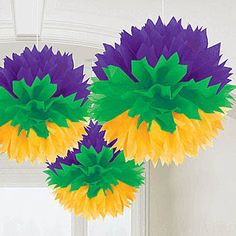 Our Mardi Gras Fluffy Decorations feature vibrant purple, green, and gold colors to make it easy to decorate for Mardi Gras.