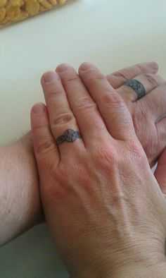 Wedding ring tattoos by suredoc- his on bottom