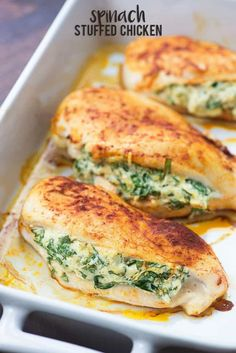 Spinach stuffed chicken breasts in white baking dish