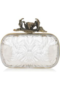 Alexander McQueenIris plexiglass box clutch– Immediately give your look an avante-garde edge. $2295 from Net-a-Porter
