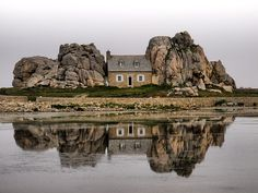 Had to pin this unusual petite structure sandwiched between enormous rock formations. Castel Meur, Plourgrescant, Bretagne, France