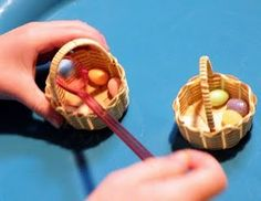 Fine Motor Skills, spooning little eggs from one basket to another