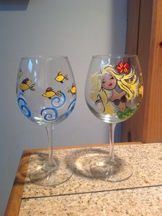 Hand painted wine glasses. Testors model paint from Hobby Lobby. Dries in 4 hours. No baking. Scratch resistant and waterproof.