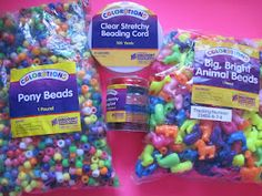 Assemble Colorful bead craft kits to make for the kids .... comes to about 25 cents each.