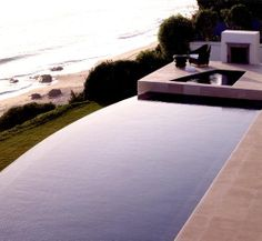 a thoughtful integration of an infinity edge pool and spa - with a coastline - magic