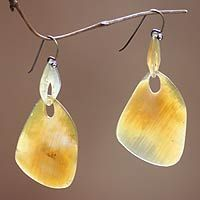 Buffalo horn dangle earrings, 'Benoa Sunrise' Sunrise at Benoa beach in Bali inspires Warren and Robbin in the design of these stunning earrings. Worn on sterling silver hooks, the earrings are hand-carved from water buffalo horn.   Please expect slight color variations due the horn's natural hues.