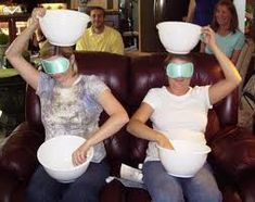 See how many cotton balls can they place  in the basket above their head using a soup spoon being blind folded