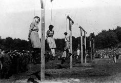 """Execution of the women SS Guards of Stutthof concentration camp for """"sadistic abuse of prisoners"""" after on trial by the Polish Special Law Court at Danzig. The women did not seem to take the trial..."""