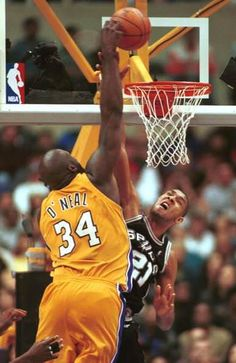 Shaquille O'Neal  over powering Tim Duncan