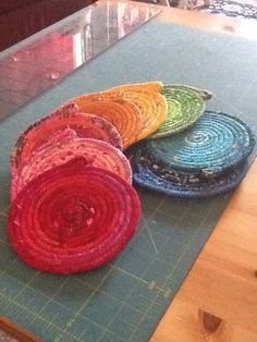 Fabric wrapped Clothesline made into coasters to coordinate with Fiestaware dishes