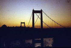 Scene at sunset, bridge over the River Tamar, Cornwall. Framed Photo. Scene at sunset, bridge over the River Tamar, Cornwall. Date: circa 1980s.