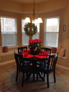 Kitchen breakfast nook decorated for Christmas.