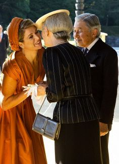 Queen Máxima and Empress Michiko, October 29, 2014 | Royal Hats....   Posted on October 29, 2014 by HatQueen.....King Willem-Alexander and Queen Máxima of the Netherlands arrived in Tokyo today for the start of a four day tour of Japan.