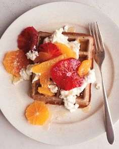 Shake up your brunch routine by forgoing the usual butter and maple syrup and topping your waffles with fresh ricotta, honey, and sliced blood oranges, Cara Caras, and tangerines instead.