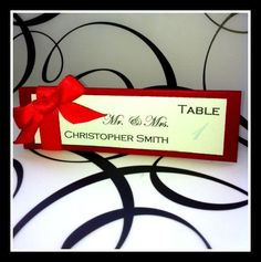Elegant red ribbon escort card for all of your by VPElegance