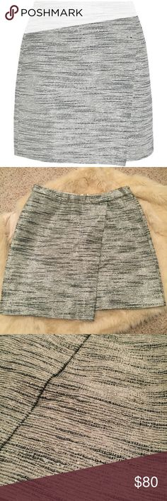 J. Crew Metallic Wrap Skirt Beautiful skirt in excellent condition, lined underneath. Size says 00 but runs slightly big. Can fit sizes 2-4. J. Crew Skirts