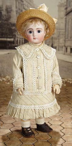 "16"" Beautiful French Bisque Bebe, Series C, by Jules Steiner in Original Costume 4500/6500 Marks: Sie C 1 (incised) J. Steiner SGDG Bourgouin succ (red stamp). Steiner (eyes signed) Le Petit Parisien (body stamp). , circa 1884."