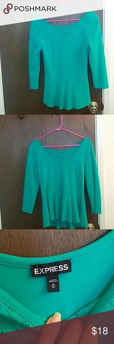 Green cotton top with eyelet sleeves from EXpress Turquoise green cotton and lace scoop neck top, 3/4 sleeves, peplum hem and eyelet sleeves.  In very good condition.  Has some stretch around the body but not lacy parts.  No trade or paypal.  Reasonable offers welcome and discount on bundles Express Tops Tees - Long Sleeve