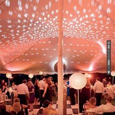 So good - Lanterns and rose lighting turn up the heat under the tent. Photo: Charles and Jennifer Maring. | CHECK OUT MORE GREAT PINK WEDDING IDEAS AT WEDDINGPINS.NET | #weddings #wedding #pink #pinkwedding #thecolorpink #events #forweddings #ilovepink #purple #fire #bright #hot #love #romance #valentines #pinky