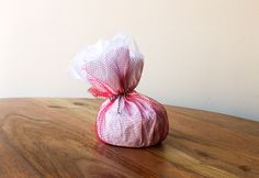 Simple gift wrapping idea using everyday materials like mesh fruit bags and tissue paper.