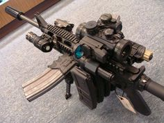 """""""Ultimate AR-15″ rifle especially designed for fighting zombies. The 23 pound gun carries 3 lasers, 4 flashlights, and 9 30 round magazines."""