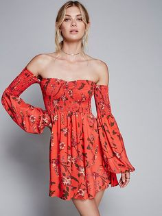 All My Lovin' Mini   In an allover floral print this American made mini dress is in an off-the-shoulder silhouette featuring a smocked elastic band at the bust. Wide sleeves with an elastic cuff.