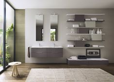 The modular system Progetto allows you to create complete solutions for bathroom decorations.